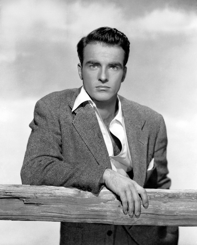 circa 1950: American actor Montgomery Clift (1920 - 1966) leaning on a fence with an intent expression.