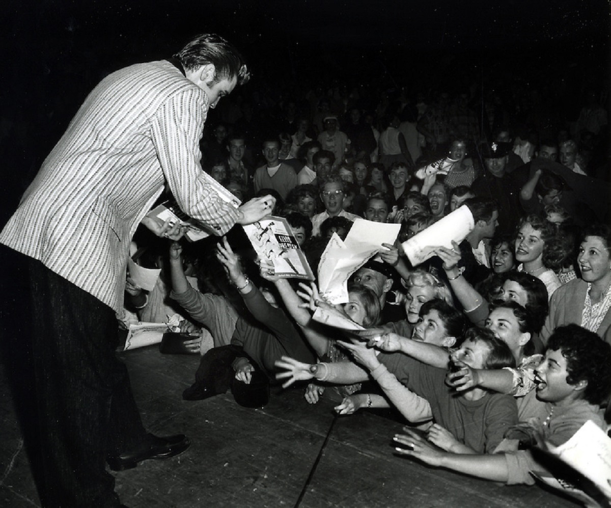 Elvis Presley signing autographs in Oakland, California on June 3, 1956.