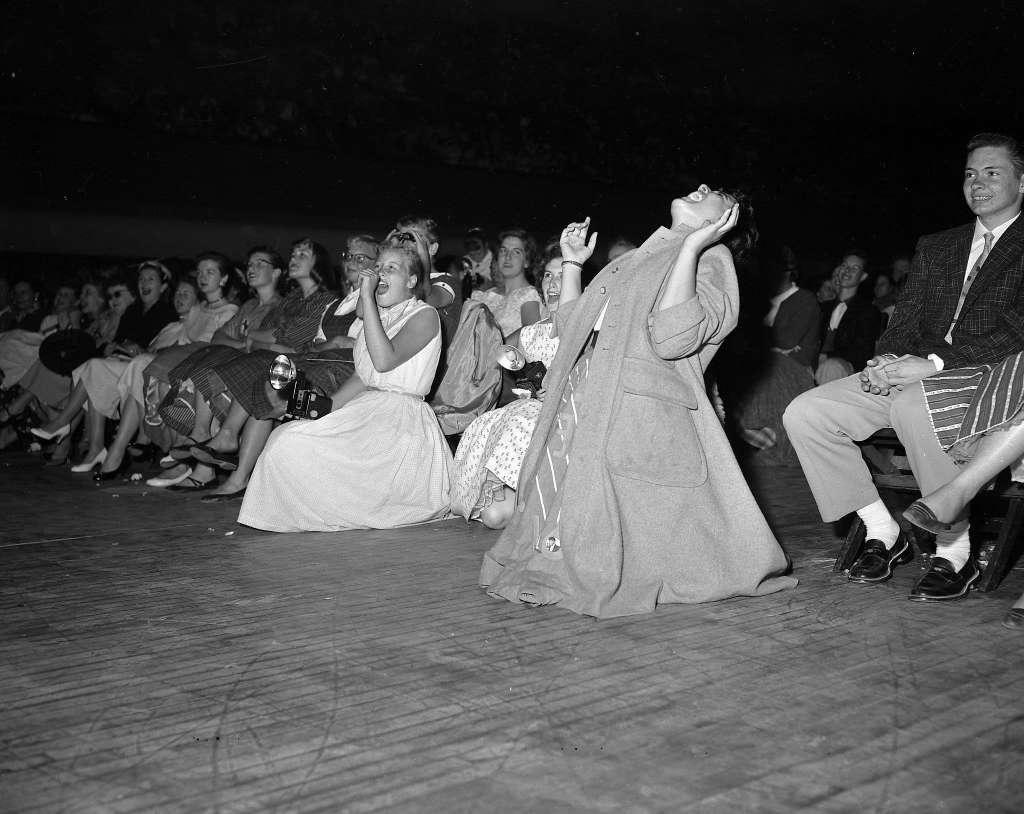 Elvis Presley performs at the Oakland Auditorium June 3, 1956.